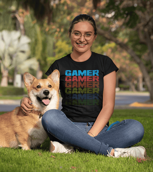 Female Siting in park with her dog wearing black T-shirt with Faded Out Gamer Design from The Xpert Apparel Store