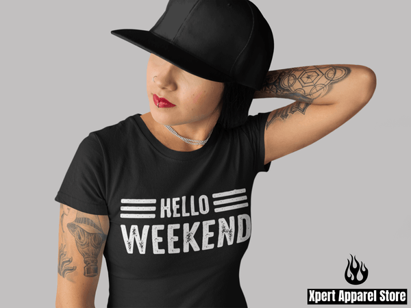 Woman with tattoos on her harm in black hat wearing a Hello Weekend T-shirt design