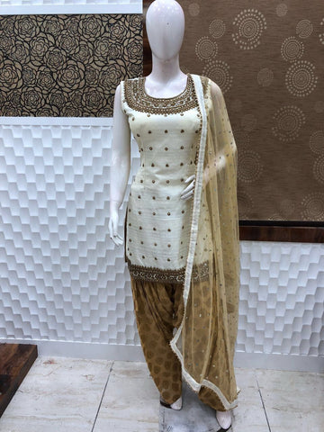 Off white and Gold Patiala, Tusser soft Silk with Banarasi silk salwar. Heavy work net dupatta.