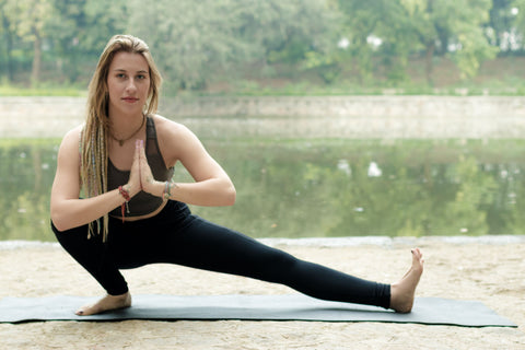 Women in Skyria Leggings and Sports bra doing Meditation