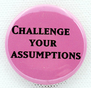 Challenge Your Assumptions 1.5 inch button