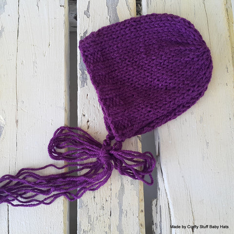 Free knitting pattern for a double knit baby bonnet