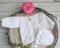handknit baby cardigan and bonnet set white baby clothes handmade uk