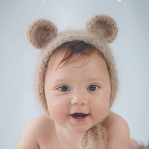 handknit fluffy bear bonnet for a babys first photographs