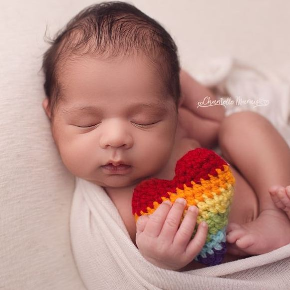 Handmade crochet rainbow striped stuffed heart for newborn rainbow baby photo prop