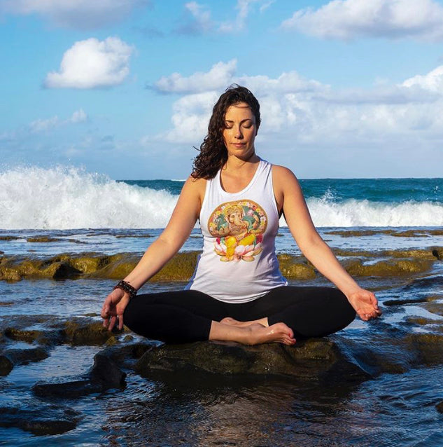 Woman meditating with breath on the beach