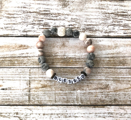 Blessed bracelet - with pink and grey beads, along with white lava beads