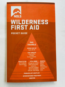 NOLS Wilderness First Aid pocket guide