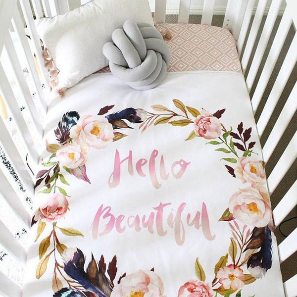 Cot with Knot Cushion and Quilt with Floral Wreath and Hello Beautiful. Knot cushion available at friday kids co. fridaykidsco.com