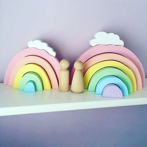 Wooden rainbow-shaped blocks with clouds. Great as a colorful ornament or a toy for children and babies. Available at Friday Kids Co