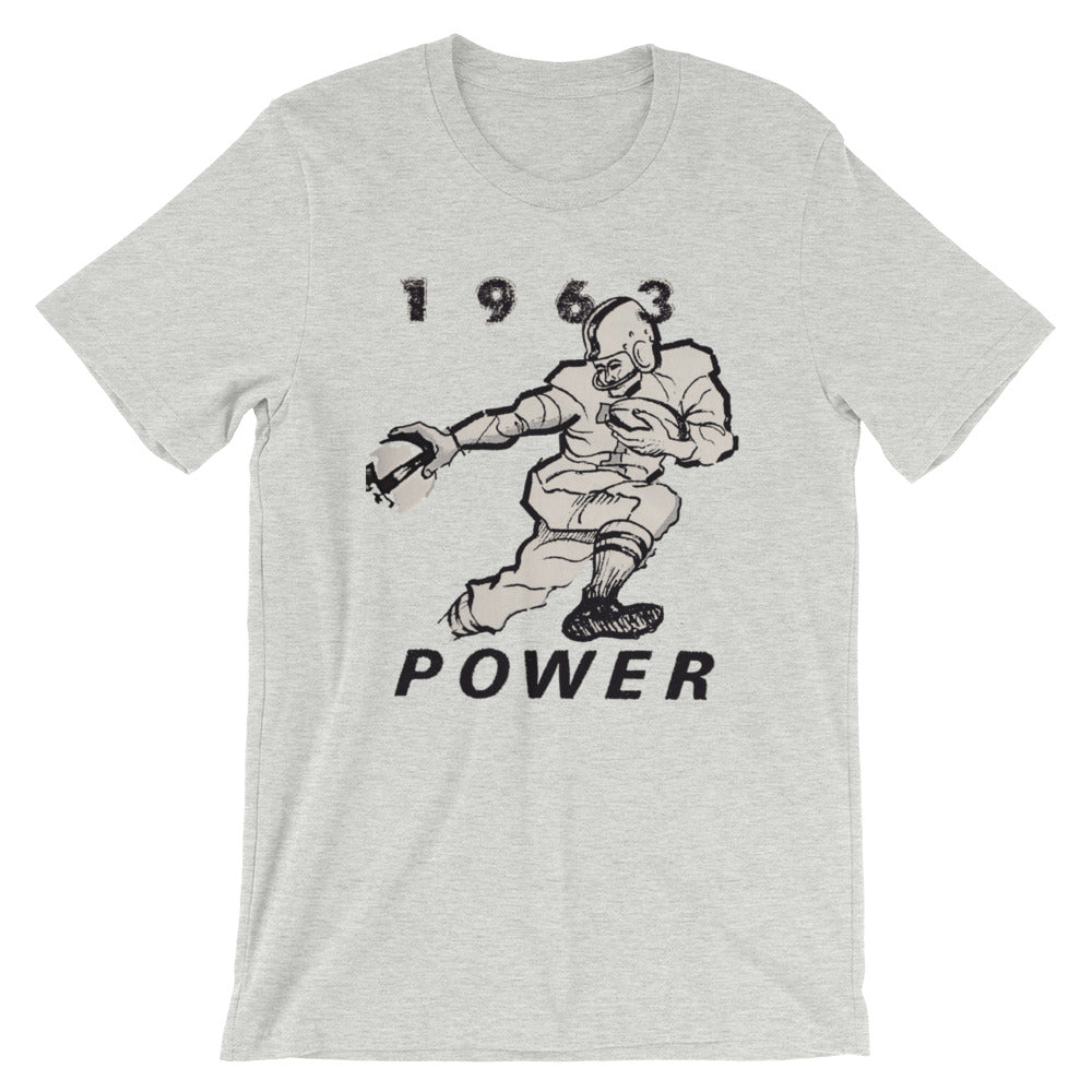 Vintage football tee designed from authentic 1963 football art in our collection. Coolstub authentic retro sports tees are stylish and fun sports clothing. This vintage gridiron tee shows a running back stiff arming a defensive player and the graphics read 1963 Power.