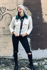 distressed white denim jacket band tee combat boots