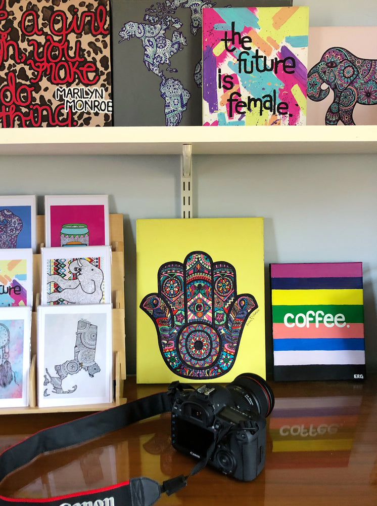 "The ""Colorful Hamsa"" original canvas is a reminder that the universe has our back. It's meant to bring its owner happiness, luck, health and good fortune."