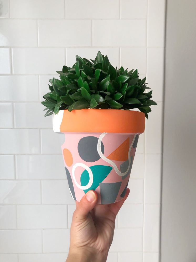 "My ""Orange Floral"" hand painted terracotta planter combines funky shapes and floral leaves to bring some brightness to your space!"