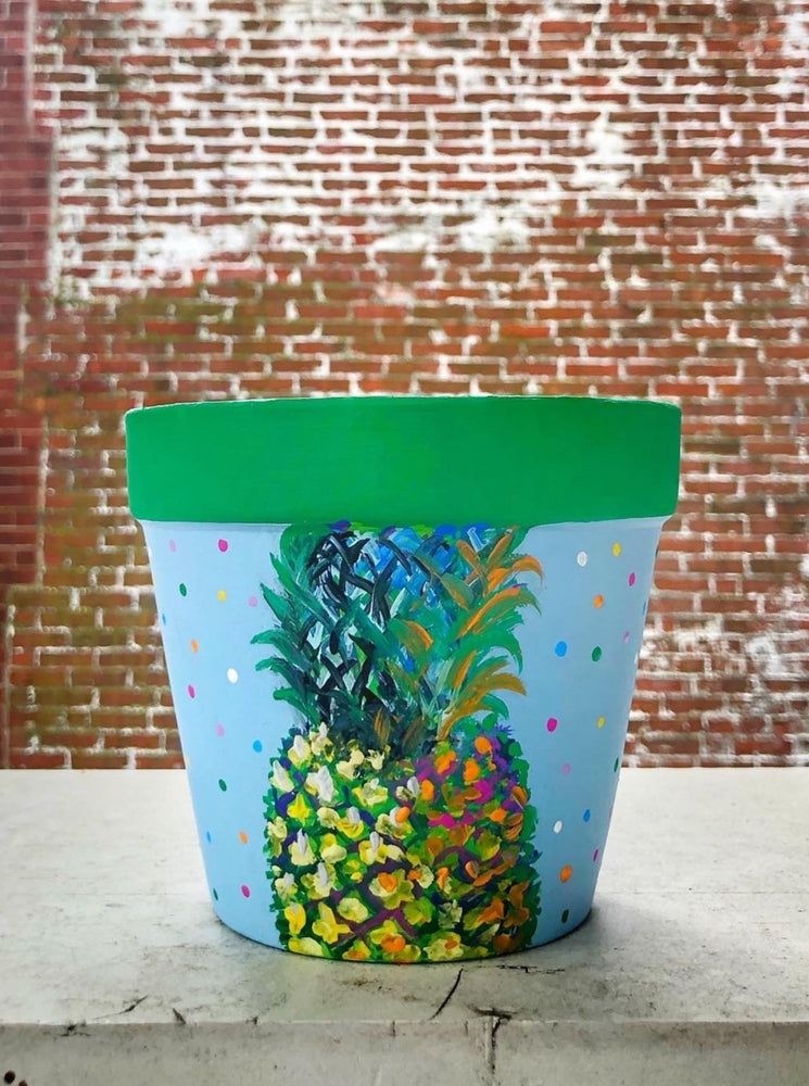 "My ""Pineapple"" hand painted terracotta planter is a symbol of welcome for your home. It's made to bring warmth, friendship and hospitality into your space."