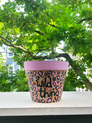 "My ""Wild Thing"" hand painted terracotta planter is designed with my favorite pattern - cheetah! It's for the woman who's not afraid to get a little wild."