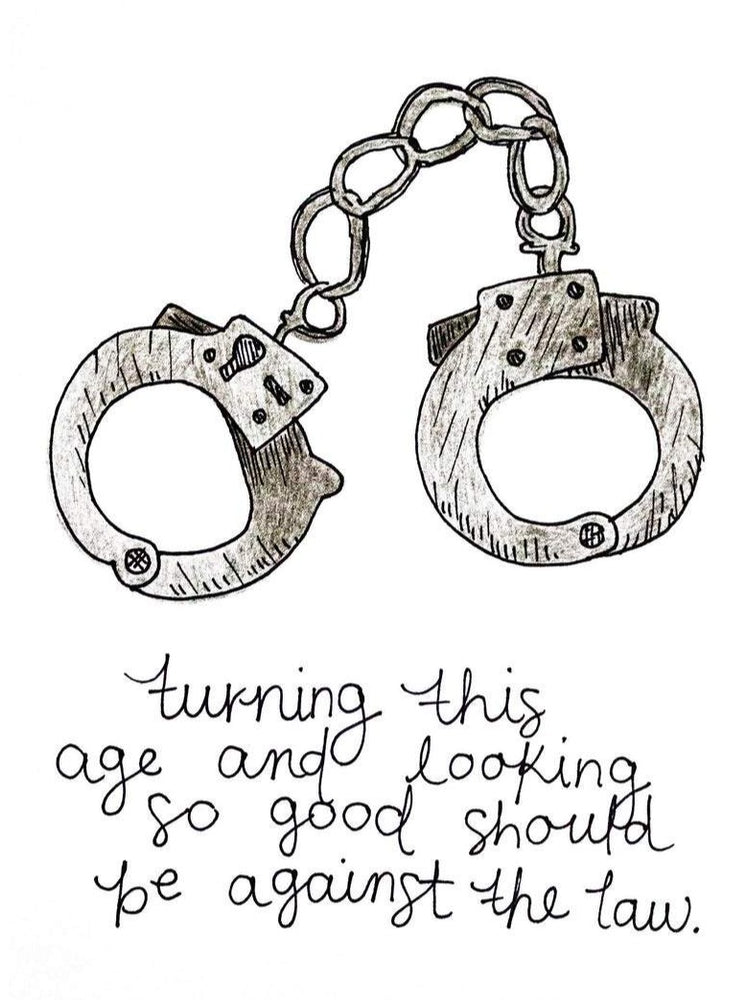 "Load image into Gallery viewer, My ""Birthday - Smooth Criminal"" greeting card is a punny handmade + hand-illustrated design meant to bring a smile to your recipient's face. Handmade 5x7 greeting card with a photo of hand cuffs that says ""Turning this age and looking so good should be against the law."""
