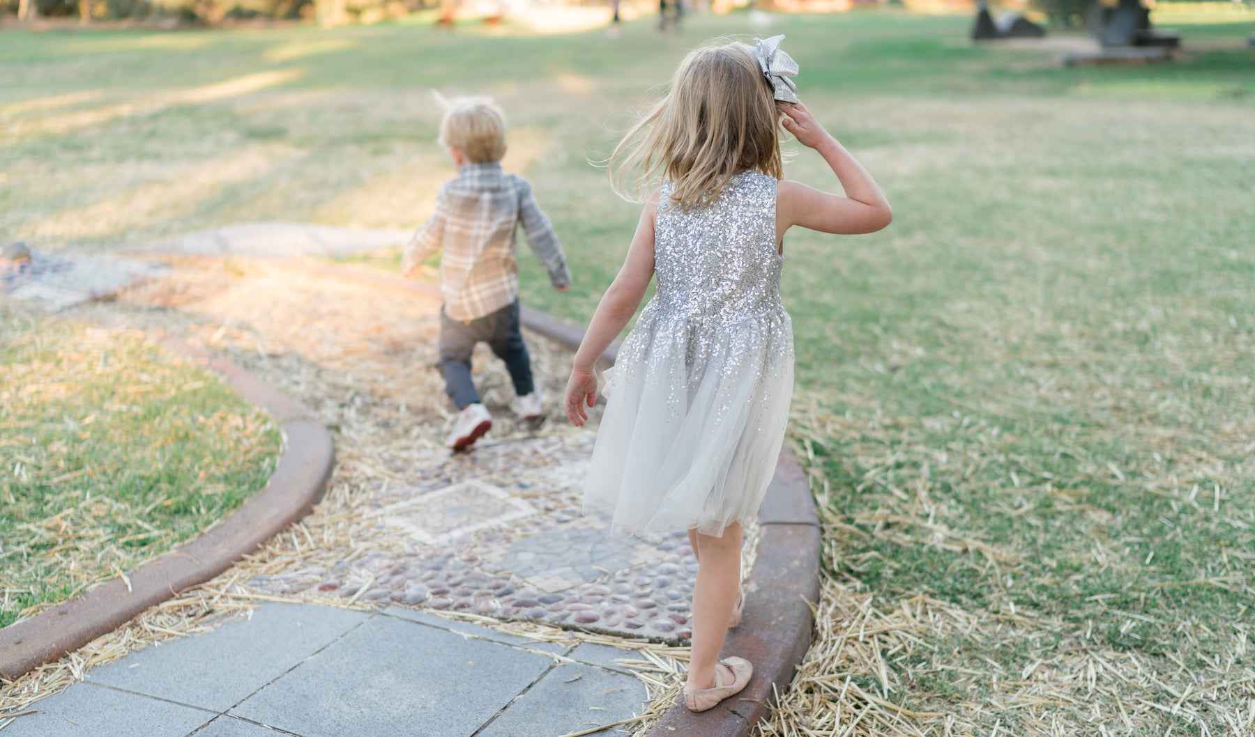 Two young kids walking away