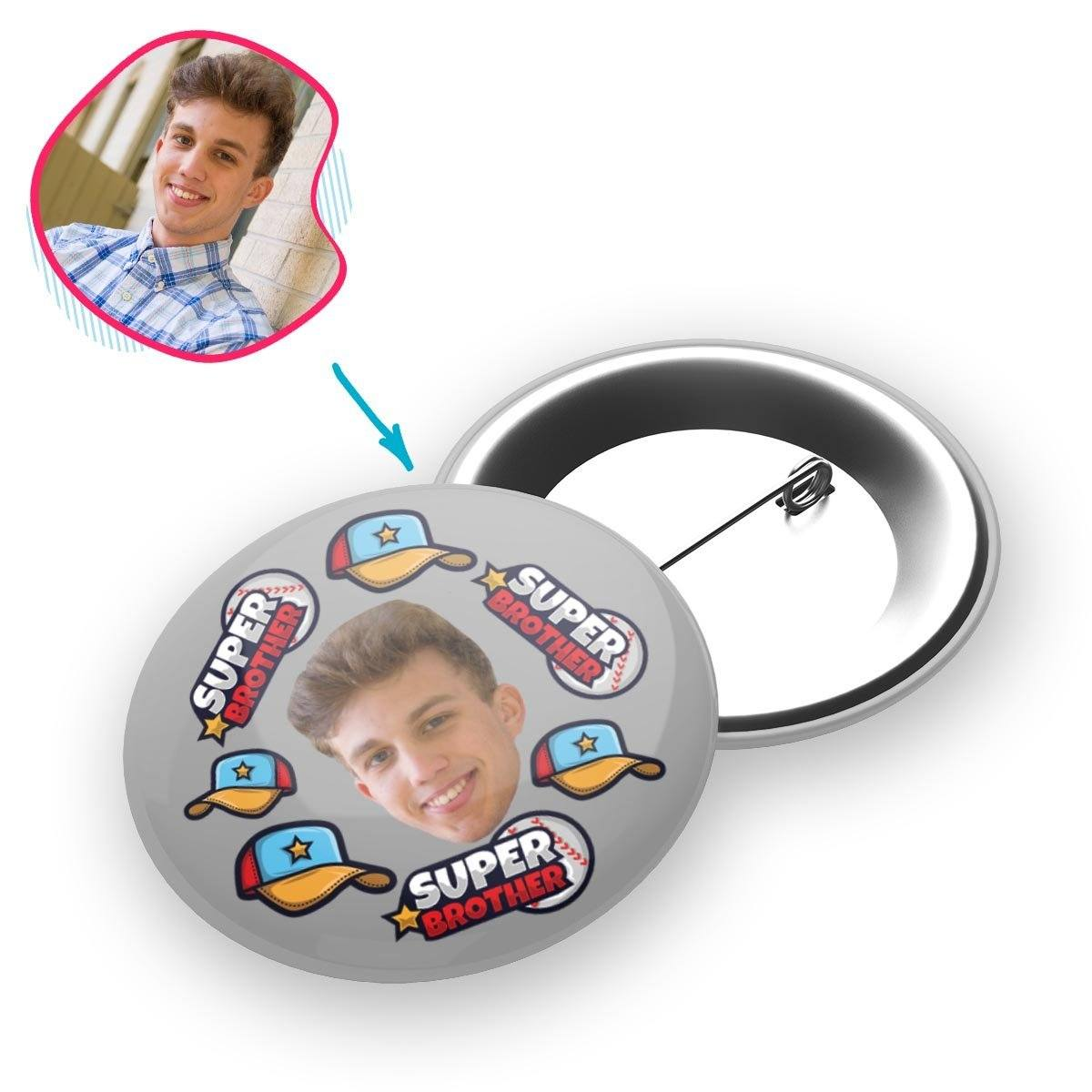 grey Super Brother pin personalized with photo of face printed on it