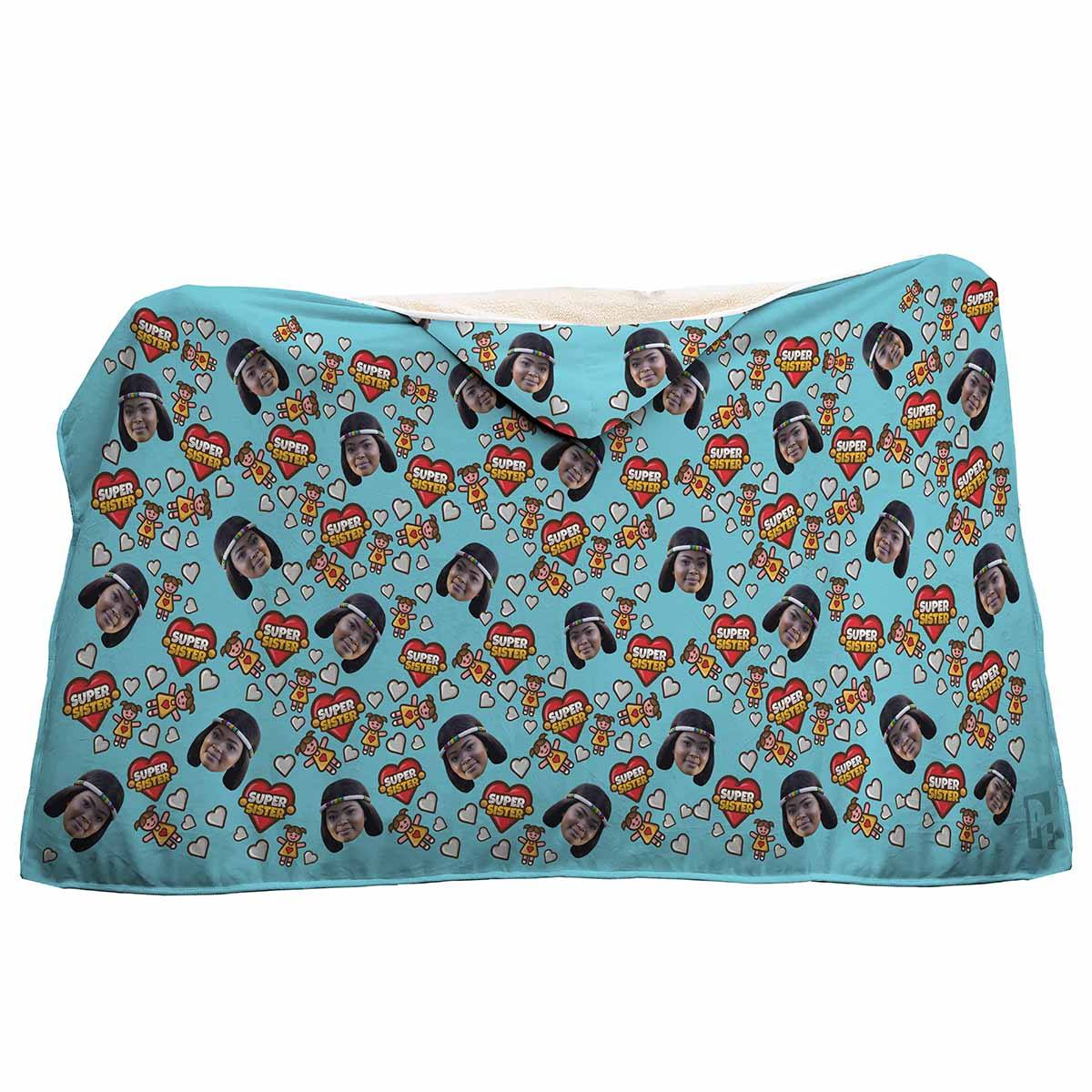 blue Super Sister hooded blanket personalized with photo of face printed on it