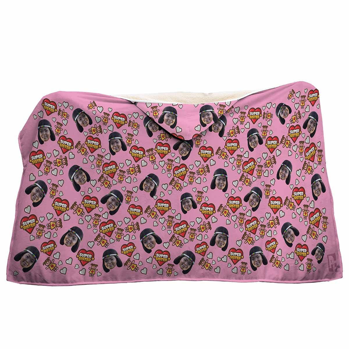 pink Super Sister hooded blanket personalized with photo of face printed on it