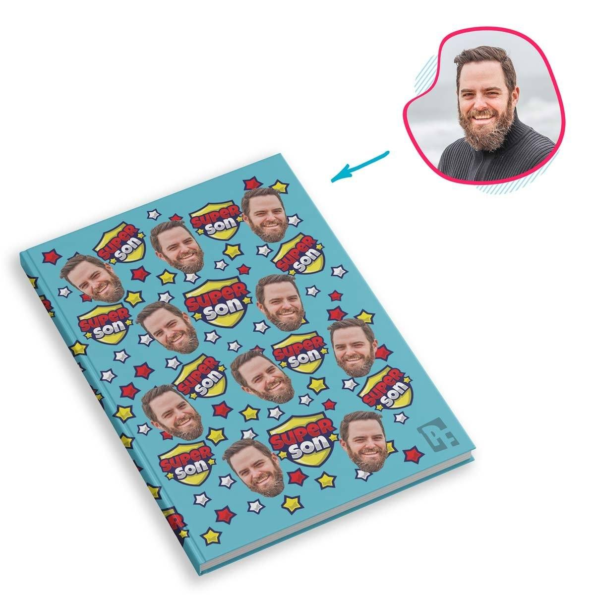 blue Super Son Notebook personalized with photo of face printed on them