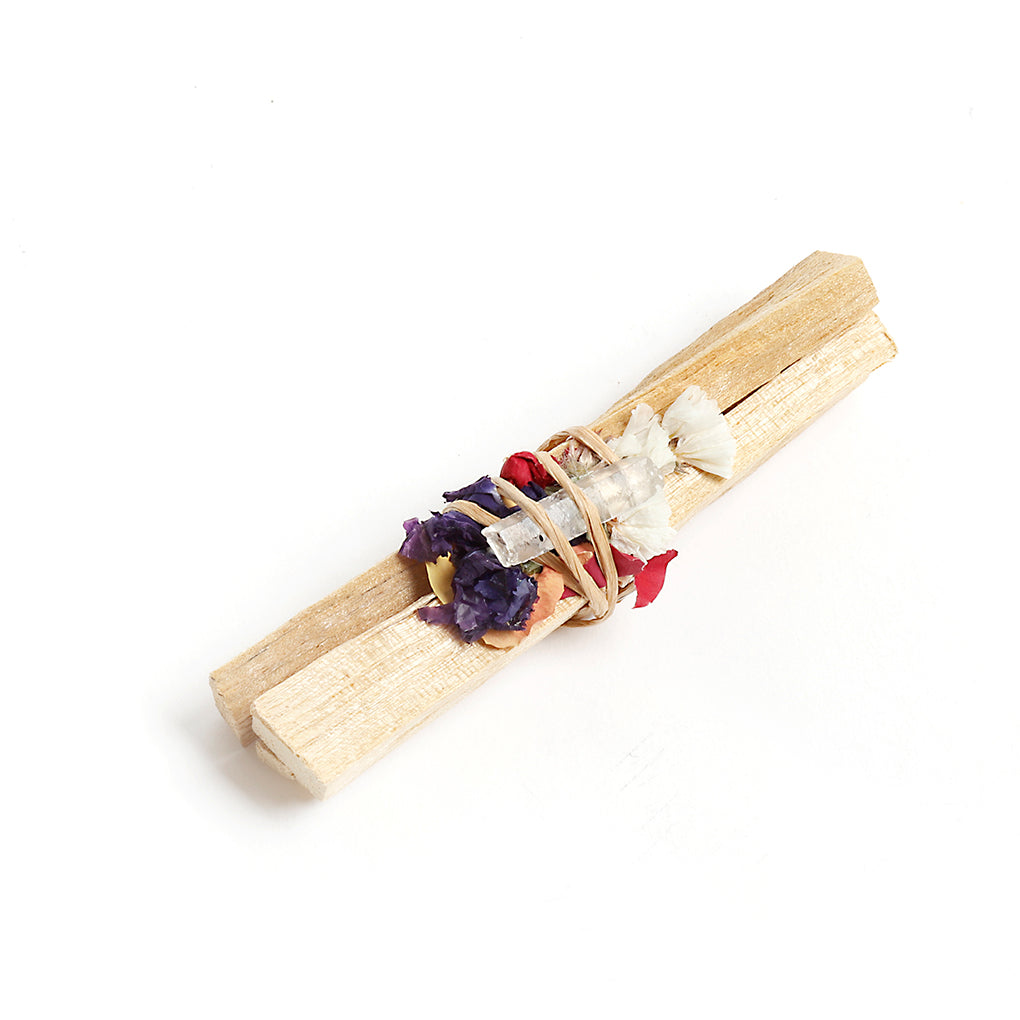 Palo Santo With Dried Flowers And A Quartz Crystal