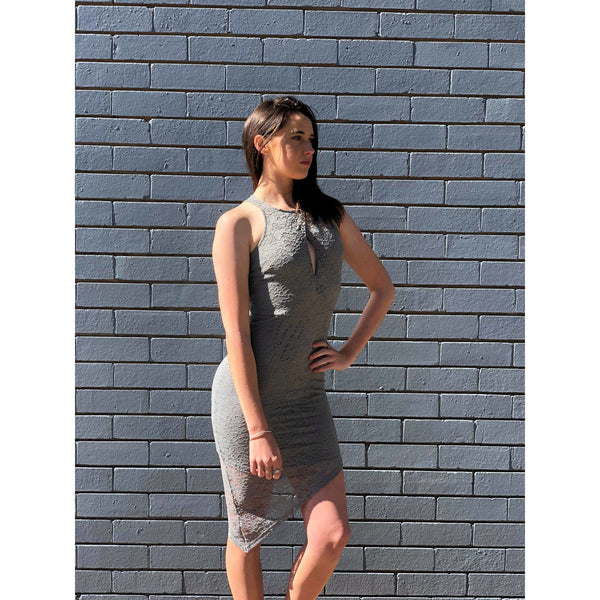 Destiny Asymmetrical Hem Lace Bodycon-This beautiful piece features an asymmetrical hemline, flattering waist seam and open panel at the bust.