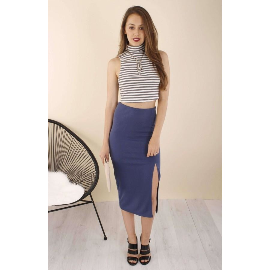 Agada Fitted Mid Skirt. Dress to impress in this figure flattering midi skirt with a sexy side split to show off some skin. Style this with a pair of strappy heels and crop top offered by Madeleine Grace The Label