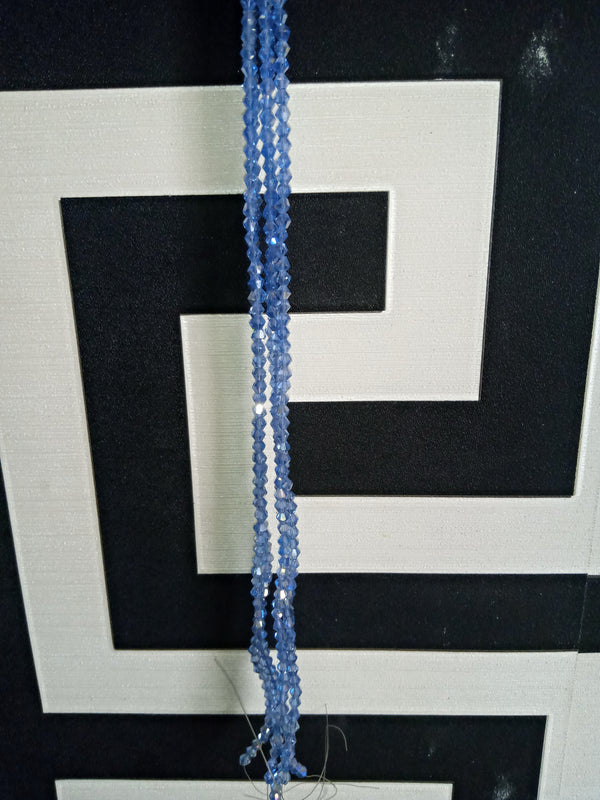 Light Blue Bicones Beads per strand