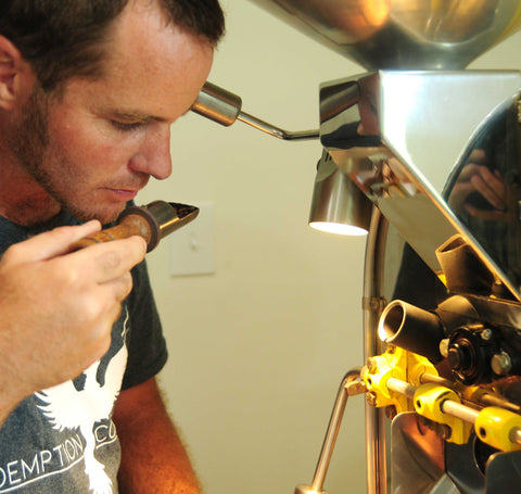 Lead Roaster smelling coffee from the tester