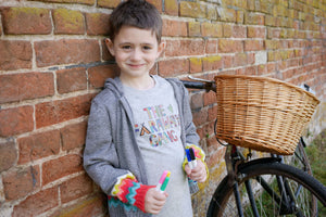 boy wearing colouring in Creativity t-shirt and wool cardigan