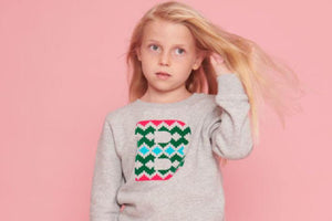 girl wearing personalised initial sweatshirt