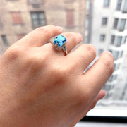 Blue Topaz Emerald Cut Ring with Diamonds