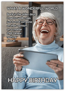 Funny Birthday Wonderful World image of older lady holding a tablet and laughing
