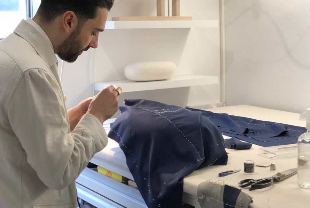 Carl Sciarra, director and bespoke tailor at Sartoria Sciarra. Italian bespoke tailors in Sydney, Australia. Working on a hand made bespoke jacket in the Sydney workroom.
