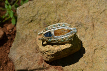 Atlantia - Imperial Topaz Blue Apatite and 8 Emeralds wrapped in Sterling Silver and 14kgf