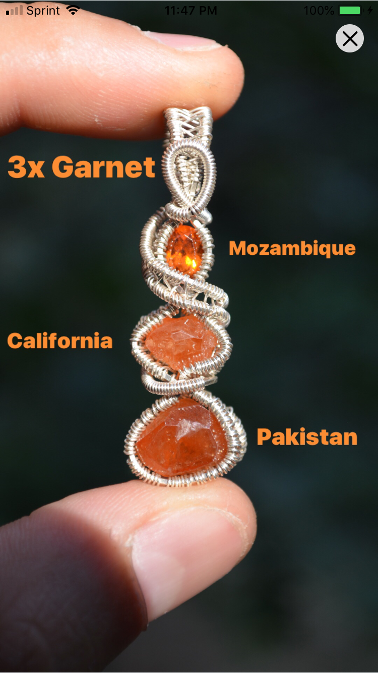 Spessartine Garnet from Mozambique California and Pakistan Wire Wrap in Sterling Silver