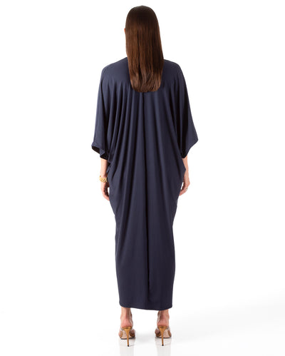 Back view of model wearing navy caftan