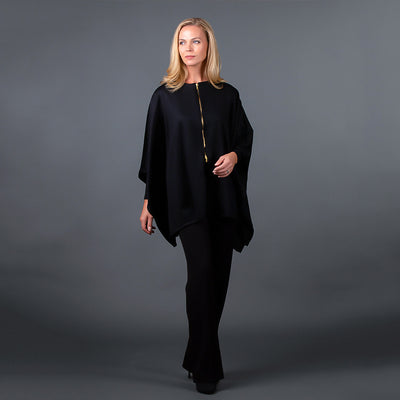Front view of black cashmere wool cape with brass zipper