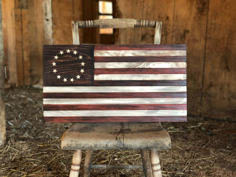 rustic wooden american flag in barn on a chair
