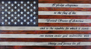 Rustic wooden American flag with the Pledge of Allegiance written in the stripes