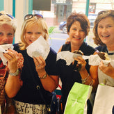 group of women eating ice cream sandwiches
