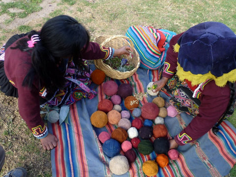 Berber women using a selection of natural dyes to colour the rug