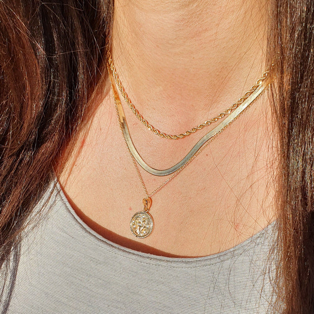 "18k gold filled, 4mm wide herringbone necklace adjustable from 16"" to 18"""