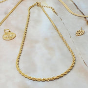 "18k gold filled, 5 mm wide rope chain adjustable from 15"" to 17"""