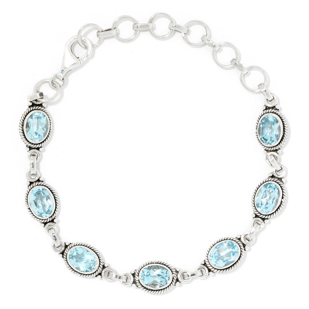 Pinctore Sterling Silver Oval Cut Blue Topaz Adjustable Line Bracelet - pinctore