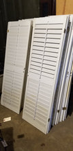 Interior wood functional louver shutters