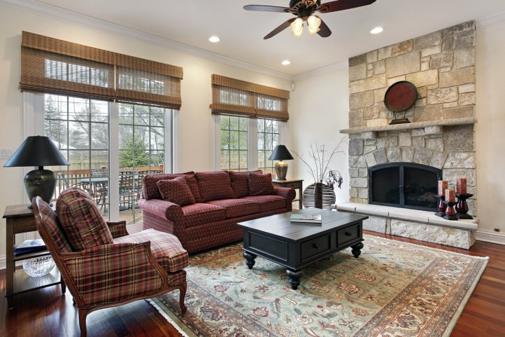 den with stone fireplace and vintage area rug