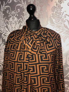 Black and tan print bow blouse